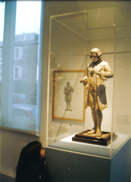 The maquette of the Birstall Statue installed in the exhibition Heavenly Creatures at the Mercer Gallery,  Harrogate, 2003. My daughter, then aged 5, trying to get an impression of what the Birstall version might look like).